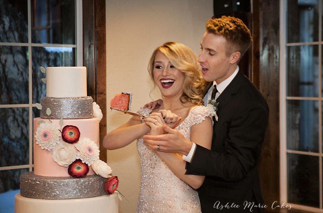 cutting the wedding cake ashlee marie cakes